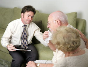 man talking to old couple