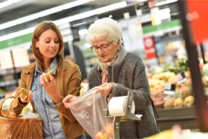 lady and old woman in the grocery store