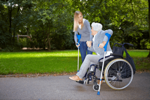 lady assisting patient in walking